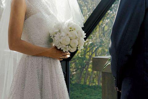 Clothing, Petal, Bridal clothing, Dress, Textile, Photograph, Flower, White, Wedding dress, Bouquet,