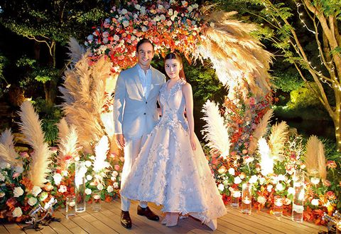Arch, Tradition, Dress, Architecture, Ceremony, Fashion, Marriage, Floral design, Event, Tree,