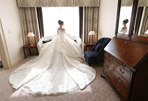 Wedding dress, Gown, Bride, Dress, Photograph, Bridal clothing, Clothing, Bridal party dress, Shoulder, Bridal accessory,