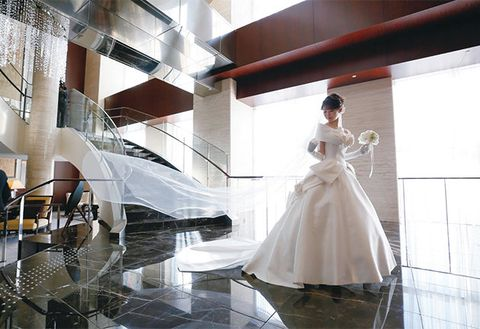 Wedding dress, Dress, Bridal clothing, Gown, Bride, Bridal accessory, Wedding, Ceremony, Room, Architecture,
