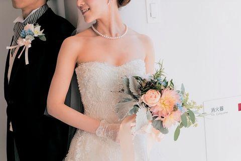 Clothing, Dress, Event, Bridal clothing, Trousers, Petal, Coat, Photograph, Bouquet, Outerwear,