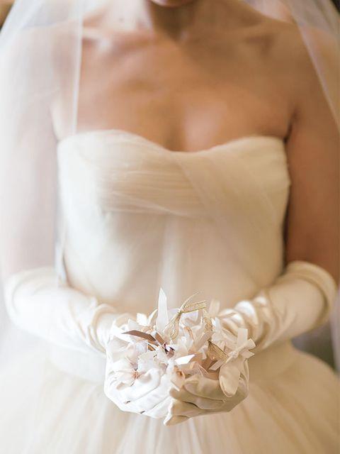 Brown, Skin, Bridal clothing, Shoulder, Bridal accessory, Joint, Elbow, Dress, Wedding dress, Petal,