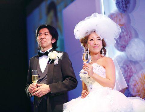 Clothing, Dress, Wine glass, Bridal clothing, Stemware, Coat, Formal wear, Drink, Fashion accessory, Wedding dress,