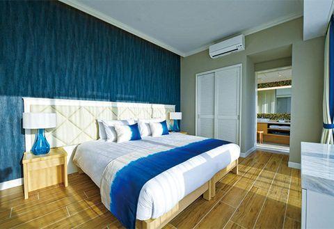 Bedroom, Bed, Room, Furniture, Interior design, Property, Wall, Bed sheet, Suite, Blue,