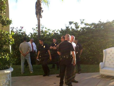 Mammal, Community, Police officer, Police, Law enforcement, Official, Palm tree, Outdoor furniture, Crew, Arecales,