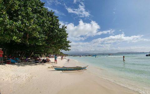 Beach, Body of water, Sky, Sea, Shore, Coast, Vacation, Ocean, Tourism, Coastal and oceanic landforms,