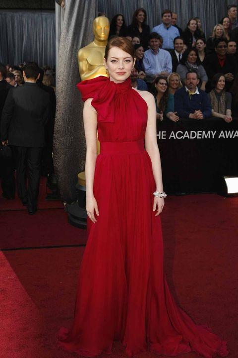 Red carpet, Fashion model, Dress, Carpet, Gown, Clothing, Flooring, Shoulder, Fashion, Red,