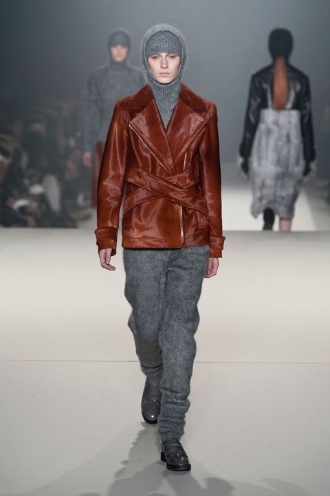 Clothing, Brown, Sleeve, Human body, Shoulder, Textile, Joint, Fashion show, Outerwear, Standing,