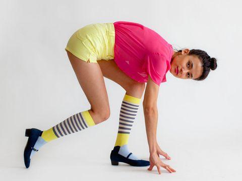 Sleeve, Human leg, Shoulder, Elbow, Textile, Joint, Pink, Knee, Sportswear, T-shirt,