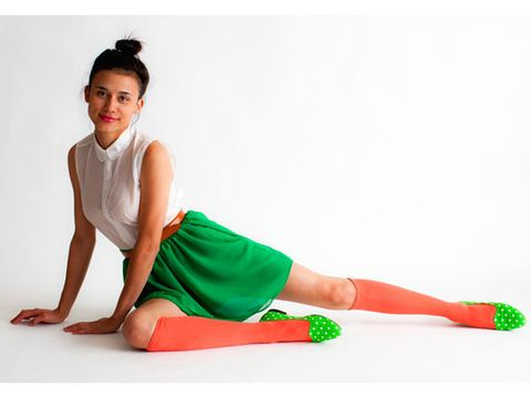 Green, Human leg, Joint, Elbow, Knee, Sitting, Thigh, Sock, Costume, Foot,