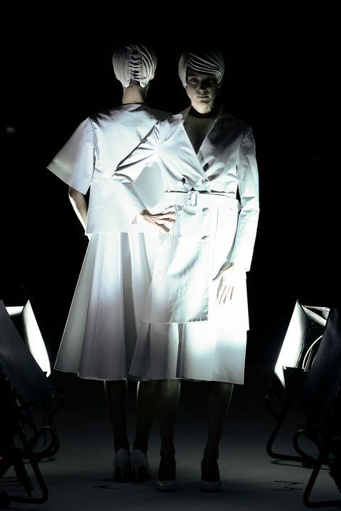 Uniform, Fashion, Performance, Human, Fashion design, Dress, Costume, Photography, Gesture, Performing arts,