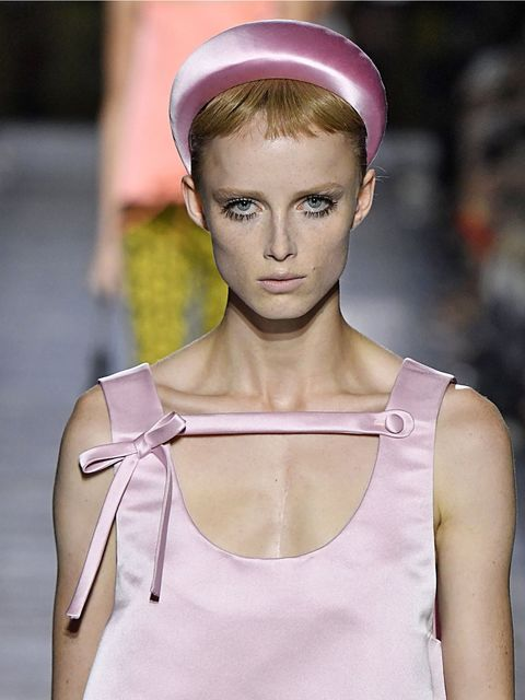 Ear, Lip, Shoulder, Joint, Sleeveless shirt, Pink, Style, Headgear, Fashion, Neck,