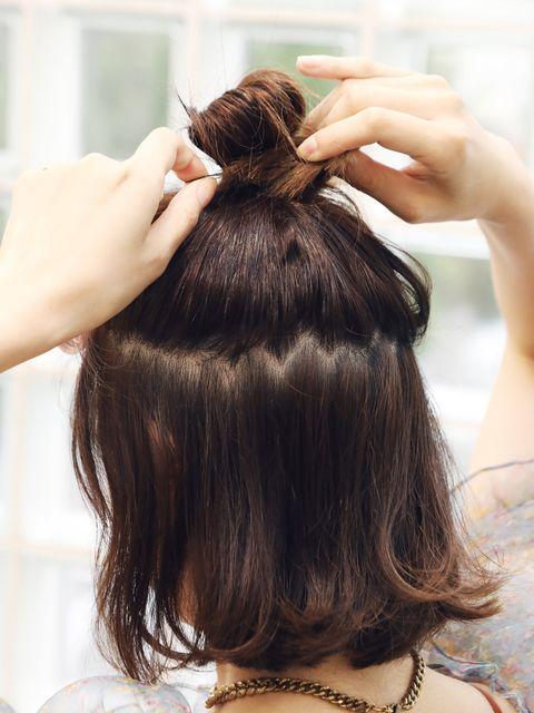 Hair, Hairstyle, Beauty salon, Hair accessory, Style, Hairdresser, Long hair, Wrist, Brown hair, Personal grooming,