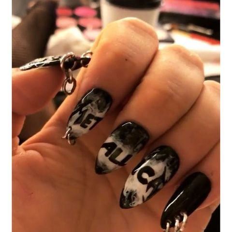 Nail, Manicure, Nail polish, Finger, Nail care, Cosmetics, Artificial nails, Skull, Hand, Service,