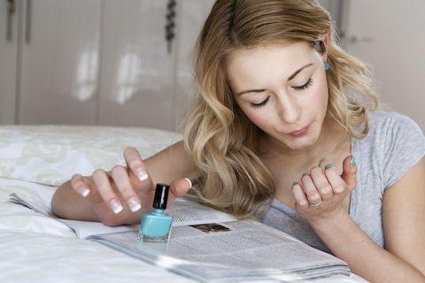 Finger, Hand, Nail, Table, Eyelash, Wrist, Cosmetics, Blond, Long hair, Nail care,