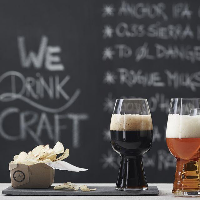 Glass, Drinkware, Stemware, Barware, Beer, Tableware, Drink, Beer glass, Serveware, Table,