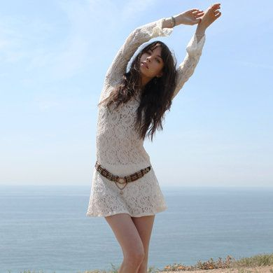 Clothing, Hair, Sky, Hairstyle, Human leg, Coastal and oceanic landforms, Shoe, Summer, People in nature, Knee,