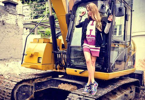 Yellow, Shoe, Human leg, Bag, Luggage and bags, Street fashion, Jacket, Blond, Machine, Construction equipment,