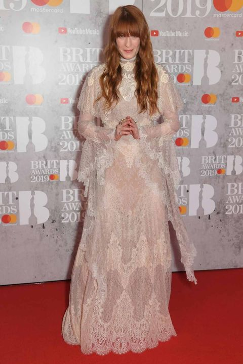 Red carpet, Carpet, Clothing, Flooring, Dress, Long hair, Premiere, Hairstyle, Fashion, Gown,