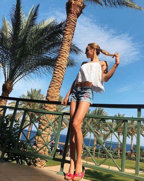 Clothing, Leg, Tree, Fashion, Beauty, Palm tree, Shorts, Summer, Fun, Arecales,