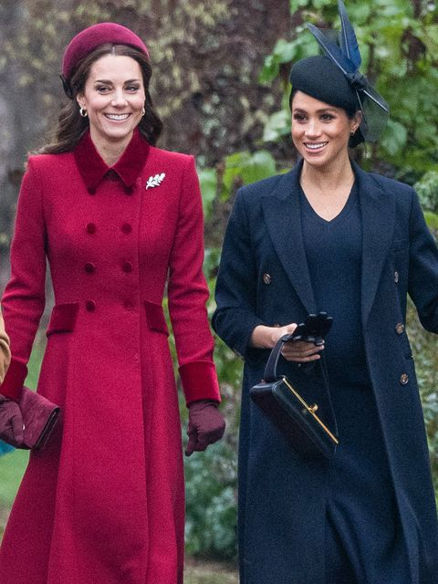 Smile, Sleeve, Outerwear, Coat, Happy, Facial expression, Formal wear, Headgear, Costume accessory, Dress,
