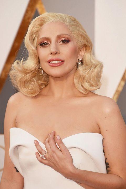 Lip, Mouth, Finger, Hairstyle, Skin, Shoulder, Eyebrow, Strapless dress, Joint, Eyelash,