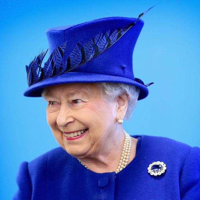 Clothing, Blue, Chin, Hat, Outerwear, Jewellery, Happy, Fashion accessory, Facial expression, Electric blue,
