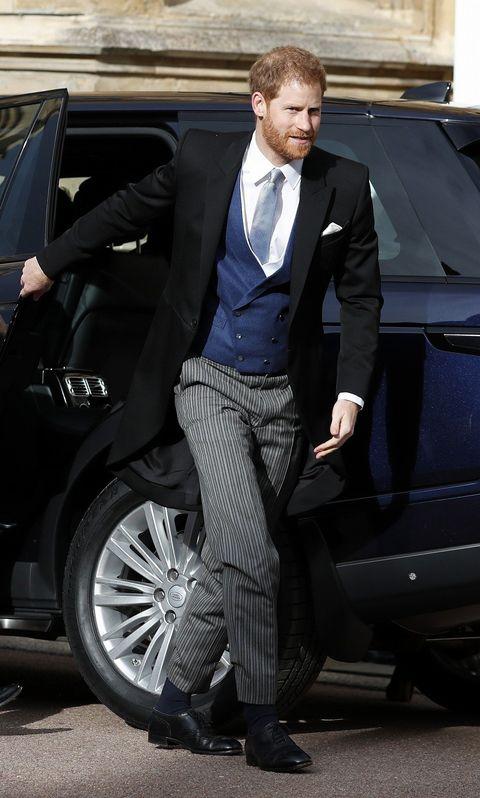 Suit, Formal wear, Clothing, Street fashion, Vehicle, Vehicle door, Tuxedo, Fashion, Car, Automotive design,