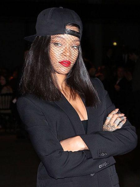 Lip, Finger, Sleeve, Cap, Darkness, Headgear, Fashion, Black hair, Street fashion, Costume accessory,