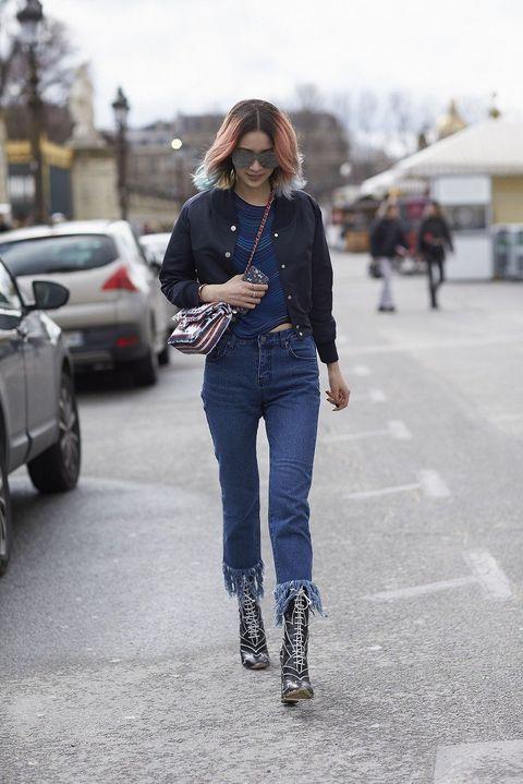 Clothing, Trousers, Road, Denim, Sunglasses, Textile, Street, Automotive tire, Outerwear, Jeans,