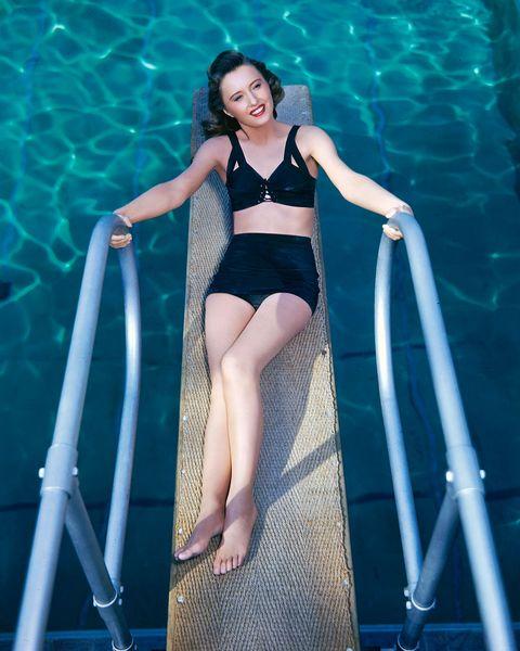 Water, Clothing, Leg, Swimwear, Beauty, Bikini, Photo shoot, Model, Human body, Swimming pool,