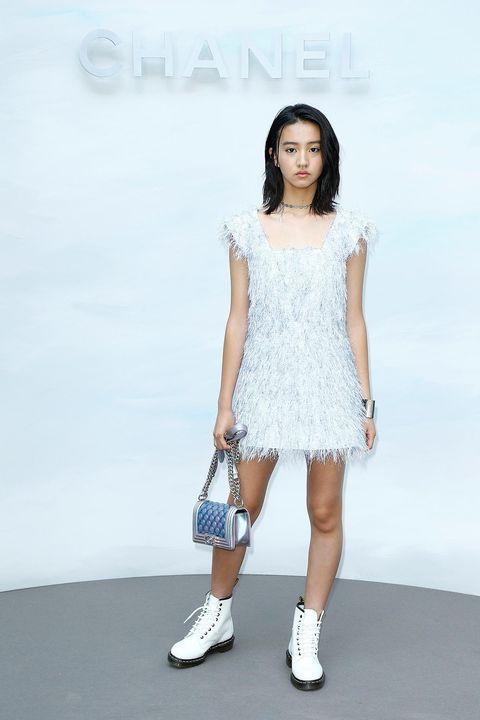 Fashion model, White, Fashion, Clothing, Shoulder, Beauty, Dress, Footwear, Fashion show, Fashion design,