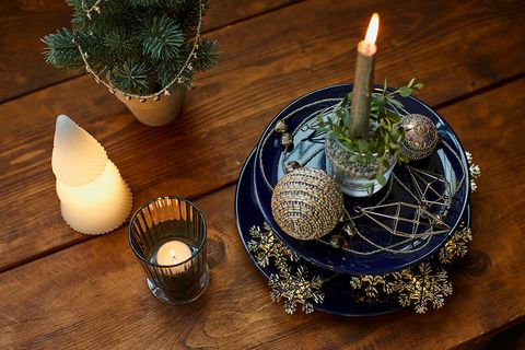 Table, Dishware, Serveware, Interior design, Candle, Porcelain, Flame, Natural material, Centrepiece, Ceramic,