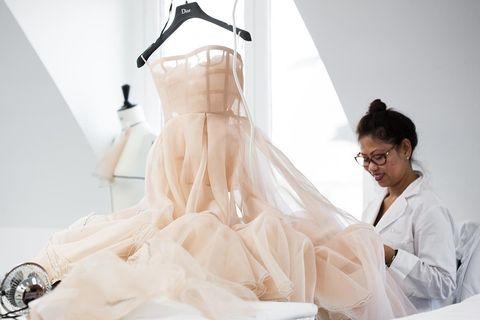White, Dress, Wedding dress, Gown, Bridal clothing, Fashion design, Bridal accessory, Bride, Veil, Formal wear,