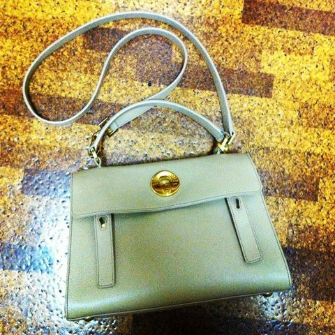 Metal, Iron, Material property, Padlock, Strap, Shoulder bag, Silver, Brand, Still life photography, Leather,