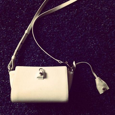 Product, White, Beige, Material property, Shoulder bag, Metal, Design, Still life photography, Brand, Label,