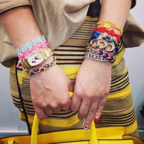 Finger, Yellow, Wrist, Joint, Nail, Pink, Magenta, Fashion accessory, Pattern, Interaction,