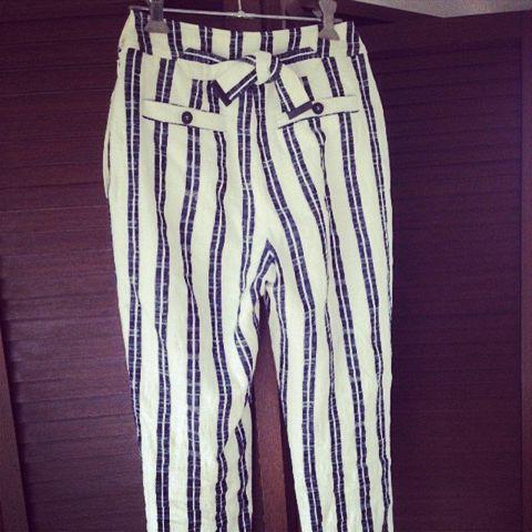Textile, Denim, Style, Pocket, Waist, Active pants, Fashion design, Bermuda shorts, Button, Suit trousers,