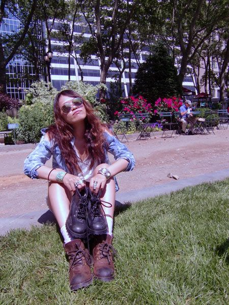 Grass, Boot, Riding boot, Liver, Street fashion, Sunglasses, Garden, Groundcover, Cowboy boot, Knee-high boot,