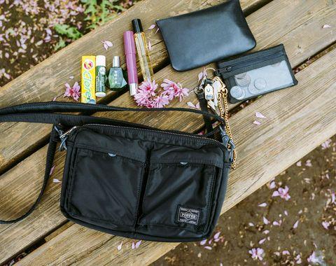 Bag, Hand luggage, Everyday carry, Material property, Fashion accessory, Messenger bag, Baggage, Zipper, Pocket, Diaper bag,