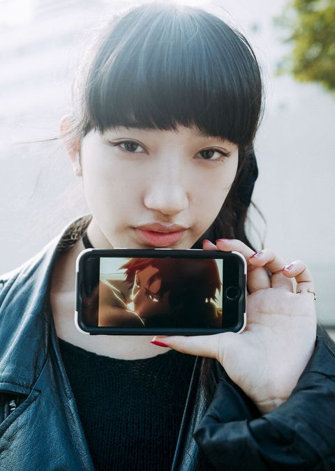 Hair, Hairstyle, Bangs, Black hair, Electronic device, Technology, Gadget, Photography, Mobile phone,