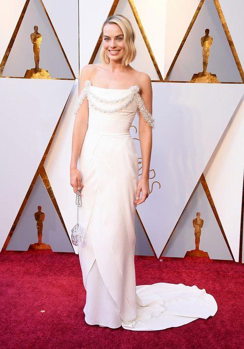 Gown, Red carpet, Dress, Carpet, Clothing, White, Wedding dress, Shoulder, Flooring, Bridal party dress,