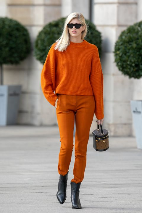 Orange, Clothing, Street fashion, Fashion, Yellow, Brown, Neck, Jeans, Footwear, Fashion model,