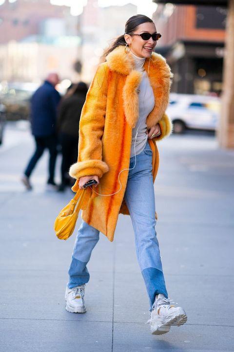 Fur, Street fashion, Clothing, Yellow, Fur clothing, Orange, Fashion, Jeans, Snapshot, Outerwear,