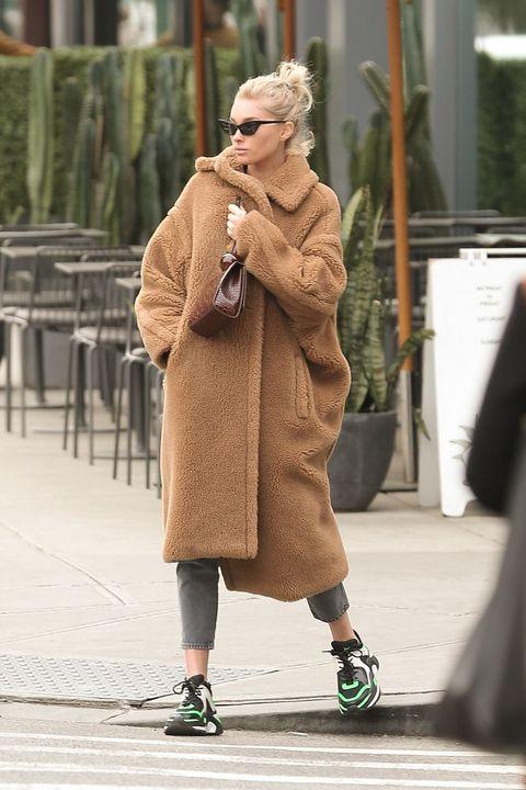 Street fashion, Photograph, Fashion, Footwear, Snapshot, Outerwear, Shoe, Eyewear, Sunglasses, Street,