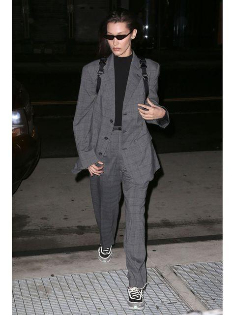 Clothing, Suit, Outerwear, Formal wear, Blazer, Fashion, Pantsuit, Tuxedo, Neck, Human,