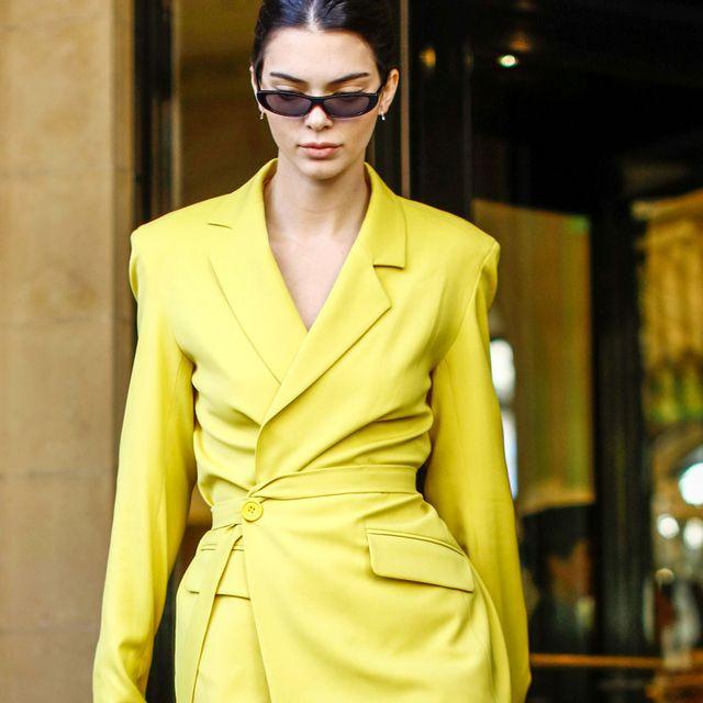 Fashion model, Clothing, Yellow, Fashion, Eyewear, Street fashion, Outerwear, Coat, Overcoat, Haute couture,