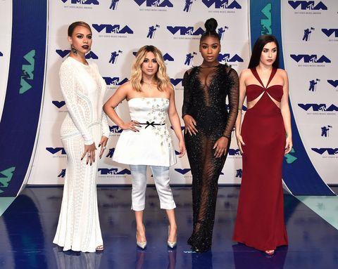 Clothing, Fashion, Red carpet, Carpet, Dress, Fashion design, Fashion model, Shoulder, Event, Premiere,