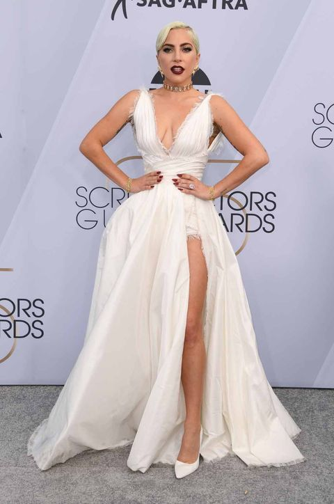 Gown, Fashion model, Clothing, Dress, Shoulder, Wedding dress, Bridal party dress, A-line, Carpet, Bridal clothing,