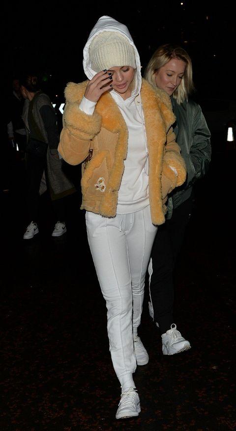 White, Clothing, Jeans, Fashion, Jacket, Outerwear, Headgear, Fun, Footwear, Leg,